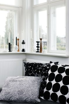 black and white pillows and candleholders