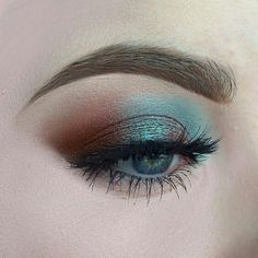 rust orange and iridescent blue shadow