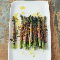 Pancetta-Wrapped Asparagus with Citronette   In Mario Batali's riff on the traditional antipasto of prosciutto-wrapped asparagus, he wraps spears in pancetta (which, unlike prosciutto, becomes nicely crispy when cooked) and grills them. Adding a bit of tanginess is the citronette, a marvelously bright-tasting mustardy-orange dressing.