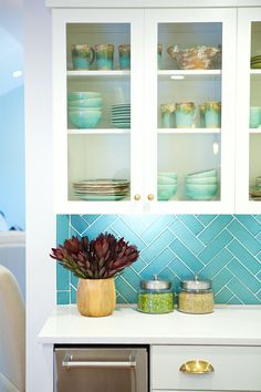 Bright turquoise tiled #backsplash in a herringbone pattern