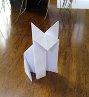 Origami, the ancient art of Chinese Paper Folding. We'll show you all of the coolest Origami designs, whether it be Dragon Origami, Origami for kids, or Origami Guns. Origami Paper Art, Origami Easy, Wolf Scouts, Cub Scouts, Art Activities For Kids, Art For Kids, Chinese Paper Folding, Easy Origami Animals, Wolf Online
