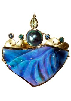Pin/pendant by Paula Crevoshay of black opal carved by Sherris Cottier Shank with gold, abalone pearl, blue zircons & moonstone (photo Amy Balthrop)