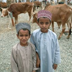 Omani kids in Nizwa cattle market - Oman (We visited this animal market.)