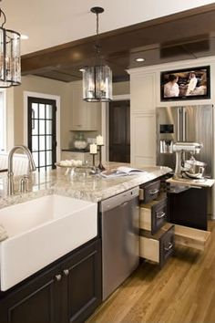 light floor, dark cabinets, light granite counters