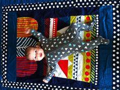 Luca on Luca's quilt