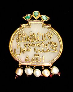 An early 20th century Rajasthan Indian jade, gold and pearl pendant.
