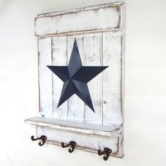 Distressed White Wood Shelf with Rustic Cast Iron Hooks and Red Barn Star - Rustic, Primitive, Country Decor; Handmade, Hand Painted by AppleFarmCreations on Etsy Vintage Farmhouse Decor, Country Farmhouse Decor, Antique Decor, Vintage Decor, Country Primitive, Country Star Decor, Barn Star Decor, Primitive Homes, Primitive Antiques
