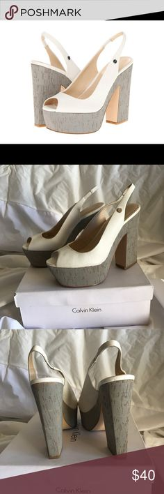 """7- Calvin Klein heels Raimy Calf Calvin Klein blocked heels. White/ Ash Gray. Some slight scuffs ( zoom in on pics for better detail) preowned but still in Good Condition. 5"""" heel. Check out my other listing for size 7 shoes. Bundling discount available. 🛍 Calvin Klein Shoes Platforms"""
