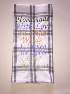Beautifully embroidered kitchen towel! Grey and white plaid design with the saying Homemade with Love In Other Words I Licked the Spoon & Kept Using It embroidered in multi colored lettering. Unique bridal, housewarming or birthday gift! Towel measures approx. 27 inches by 18 inches, made of cotton, machine wash, iron as needed.