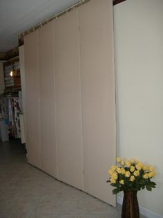2 sided design wall - 1 cream the other is dark - also rod in front for finished quilts