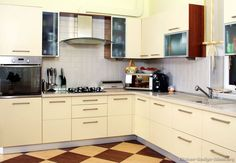 #Kitchen Idea of the Day: Modern Cream-Colored Kitchen with checkerboard flooring.