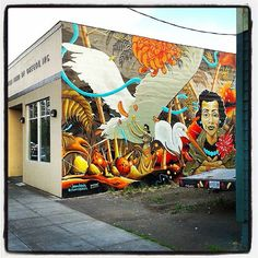 Black United Fund mural in Portland Oregon by eatcho and plastic birdie