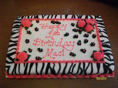 12x18 1/2 chocolate 1/2 vanilla  Buttercream icing  Zebra print done with fondant  Hot pink roses and black drop flowers