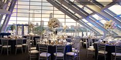 A Wedding reception decor picture of the Skyline Solarium. This venue space has an amazing view of the iconic Chicago skyline.  The venue is 3,700 sq ft. and can hold multiple people. A detailed capacity chart is listed below  Capacity:  325 – Seated Dinner with Dance Floor 375 – Seated Dinner without Dance Floor 475 – Cocktail Reception 1200 – Standing Reception