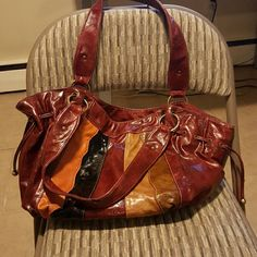 Great bookbag Use to use this bag as bookbag carrying two or three books at a time plus other purse accessories. Straps at tops show signs of wear and tear. Also will take offers! Bags Satchels