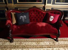 red velvet settee, paint the wood black and done.