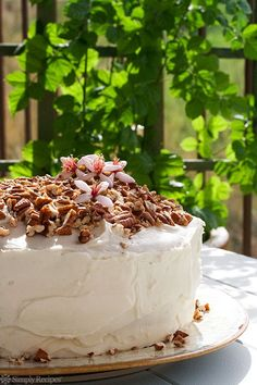 Hummingbird Cake ~ Classic Southern cake made with bananas, pineapple, chopped pecans, and topped with a cream cheese frosting, and more pecans. Great for a holiday gathering! ~ SimplyRecipes.com