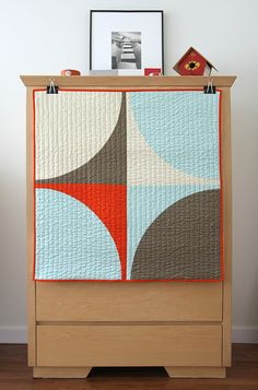 I REALLY like this. Maybe make 4 quarters of this and have a throw?Graphic Modern Baby Quilt - POP