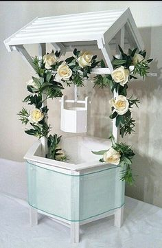 Wedding wishing well ♥♥♥ How pretty when it's decorated with the rose vine and aqua organza sash!