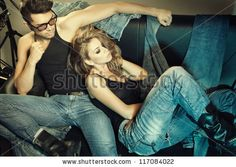 Sexy man and woman doing a fashion photo shoot in a professional studio - retro colorized photo