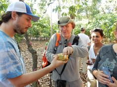 Lee from Madécasse checking out raw cocoa beans with TM Volunteers Sam and Kavita