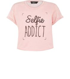 Teens. This 'Selfie Addict' tee is perfect for adding some character to summer looks.- Simple short sleeves- Classic crew neckline- Casual fit- Soft cotton fabric- Cropped design- Burnout effect
