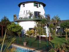 Cape Oasis Guest House - Cape Oasis Guest House is the only guests house situated next to the Rietvlei Nature Reserve with direct access to its water sport club facilities.  Breathtaking views of Table Mountain and its surrounding ... #weekendgetaways #bloubergstrand #southafrica