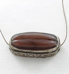 VINTAGE TIBETAN CARNELIAN HAIR BEAD CARVED from New World Gems