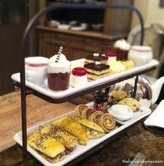 Mini opéra, mini lemon tart, blueberry puff pastry, strawberry cheesecake, raspberry  soufflé & chocolate mousse at high tea