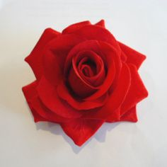 Rose hair clip. Available in beautiful rich shades - wear them alone or in a grouping in your hair.