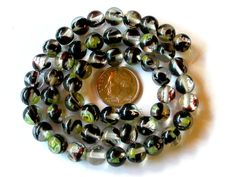 Black and Green Glass Beads  8mm Millefiori Beads 50 by wimsy (Craft Supplies & Tools, Jewelry & Beading Supplies, Beads, black green beads, millefiori beads, 8mm millefiori beads, 50 black green beads, 50 millefiori beads, shiny beads, 8mm beads, 50 beads, green millefiori, flower beads, wimsy)