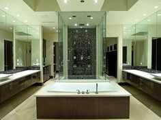 Master bathroom with dark brown vanities and black tile shower
