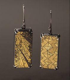 "'To Be Seen Again' Earrings in 24kt gold leaf, plexiglass, enameled steel and sterling silver. 1 1/4 x 1/2 x 1/4""."