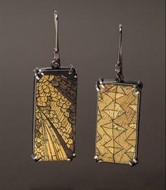 "'To Be Seen Again' Earrings in 24kt gold leaf, plexiglass, enameled steel and sterling silver. 1 1/4 x 1/2 x 1/4""."