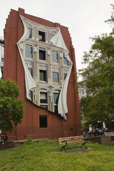 Toronto, Canada - On the edge of the financial district and Old Town lies the flatiron Gooderham Building with its Flatiron Mural, by Canadian artist Derek Michael Besant. This is just one of the many examples of impressive public art pieces scattered throughout the city.