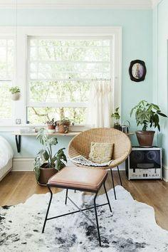 shelf below window for plants. Mint walls. Soft peach.