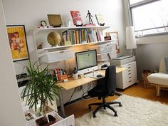 I *adore* artist Julia Denos and her workspace is just beautiful! Things of note: having a plant instantly brings life to your workspace AND white walls make for a clean canvas to display all your goodies.