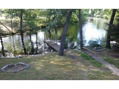 Price reflects NEW septic to be installed!.Locustville Pond Waterfront with Newer Dock! Upgrades Include Well, Roof, Windows, Exterior and Hot Water Tank....