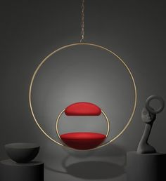 The Hanging Hoop Chair by Lee Broom