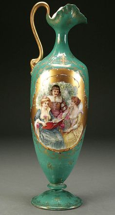 """PROV SAXE ES GERMANY PORTRAIT TANKARD circa 1900, with large transfer scene of woman and book on obverse and woman with mandolin on reverse. Damage to base. Estimate $300-$500For example of similar decoration, see """"Collector's Encyclopedia of R.S. Prussia, Fourth Series"""" by Mary Frank Gaston, page 218."""