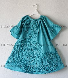 LillyAnnaKids Grey Ruffled Rosette Swing Dress by LillyAnnaKids, $44.00