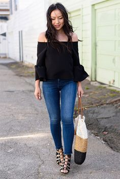 summer outfit, casual outfit, comfy outfit, street style, summer getaway outfit, summer vacation outfit, summer travel outfit - black long sleeve off the shoulder top, skinny jeans, black low heel gladiator sandals, stripe straw bag