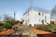 A Second World War RAF control tower in Essex has been transformed into a stylish open-pla...