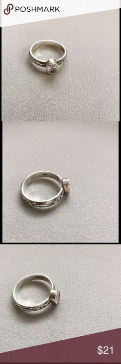 Sterling silver cz ring Made in Israel with pretty oxidized patterns on the band and cabochon cz in the center.  Never worn; has always been too loose on my finger. Jewelry Rings