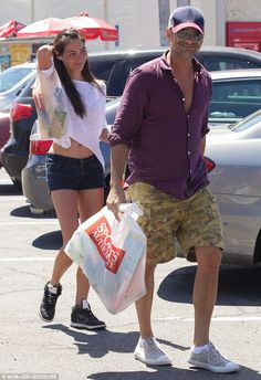 Sun's out, legs out! John Stamos, 52, enjoyed a laid-back Tuesday of retail therapy with pretty girlfriend Caitlin McHugh in Los Angeles