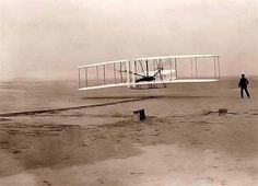 "First Flight - The world changed at 10:35 AM, on December 17, 1903 on the north side of Kill Devil Hill, Kitty Hawk, North Carolina. It was at that moment that the Wright Brother's ""Wright Flyer"", with Orville Wright at the controls, lifted off in sustained, controlled flight."