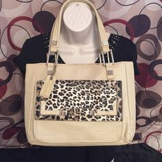 """❤️SALE❤️Christian Audigier cheetah leather handbag Christian Audigier cheetah faux leather handbag. Gold tone hardware and cream leather like material, excellent quality! Inside is pristine and slight flaws are on bottom and side (only really noticeable if looking for them). Mini to medium in size. Measurements: 12"""" long, 10"""" high, 4"""" wide, handle drop is 8."""" NO TRADES. NEGOTIATE VIA OFFER BUTTON. Christian Audigier Bags Mini Bags"""