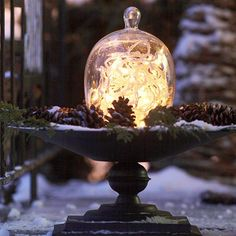 Outdoor Christmas Decorating Ideas--use a white lite globe on a bird bath