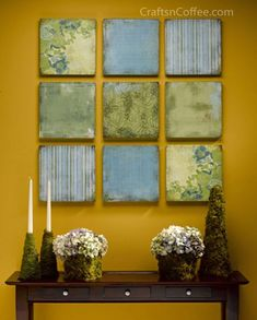 Scrap booking paper glued to styrofoam for wall decor--- love this idea for the rec room! or even upstairs hallway.