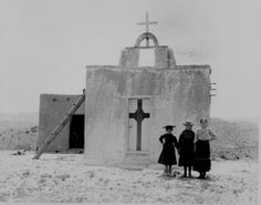Children in their Sunday clothes pose in front of adobe church - New Mexico, 1908
